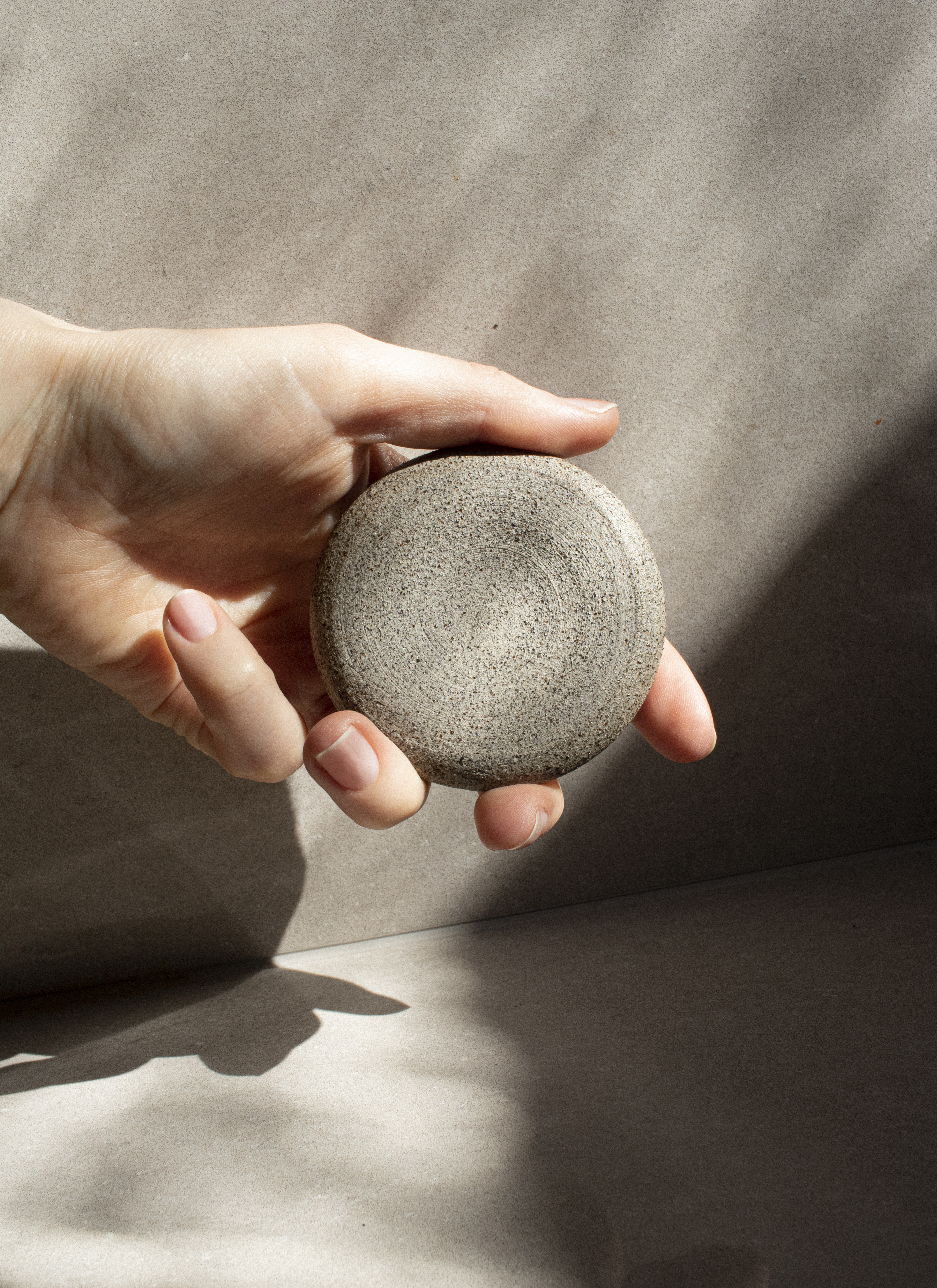A handmade diffuser stone that spreads the scent of essential oils, made in off-white clay. Each stone is unique, with a fine texture that hints about the craftsmanship behind it and adds a calm feeling to every room. A sense of space to be.